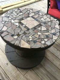 My table I made from a wooden spool and broken tiles