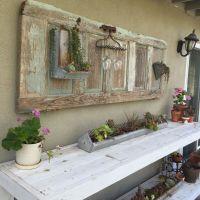 Old door repurposed. Chicken feeder planters with ...