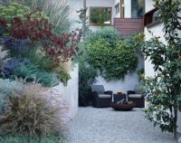 small city walled garden, gravel courtyard, mix of ...