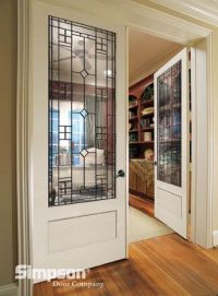 Decorative glass French doors define this home office ...