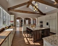 Beautiful two-tone kitchen with vaulted ceiling beams ...
