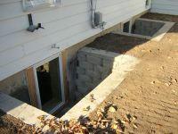 egress window wells | ... stone wells exterior stone wells ...