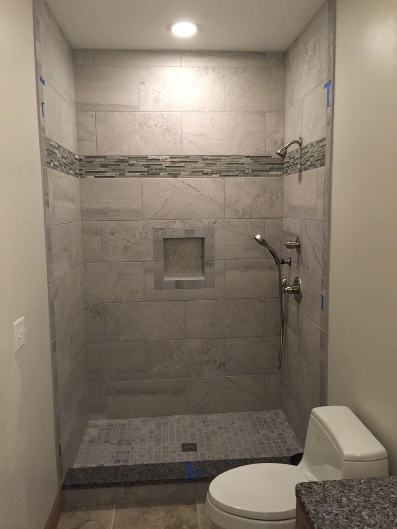 12x24 grey wall tiles, shower niche, 2x2 mosaic floor