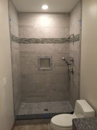 12x24 grey wall tiles, shower niche, 2x2 mosaic floor