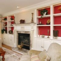 Shallow shelves over cabinets flanking fireplace - red ...
