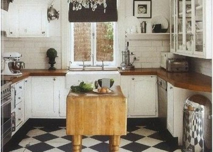 Subway tile in the kitchen butcher block also blocks tiles and white