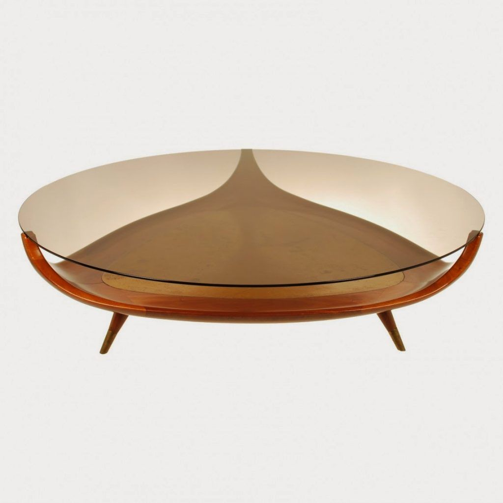 small modern oval glass top coffee table with triangle wooden base