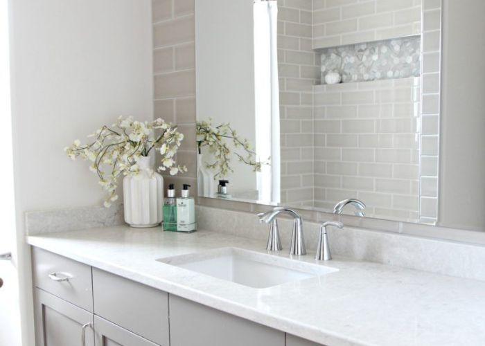 Bathroom remodel moen glyde fixtures bianco drift quartz countertop caesarstone subway tile wall also