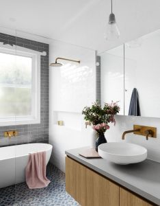 Lovely floor tiles and general colour theme bathroom kitchen renovations design melbourne gia also patterned tile pairs with pink towels  add color to your rh uk pinterest