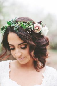 Boho wedding hairstyles. A flower crown and a curly updo