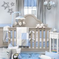 Tasteful Baby Blue and Grey Nursery Room with Grey Crib