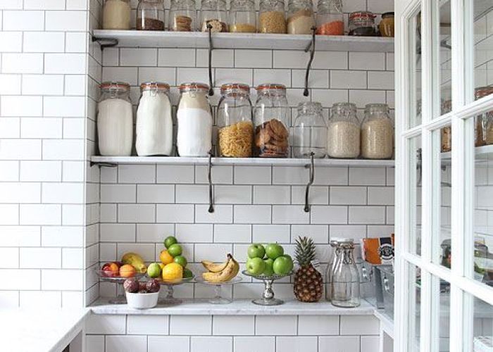 White metro tiled pantry with open shelving side window and glass storage jars for  retro shop look also subway tiles black grout cocinas pinterest