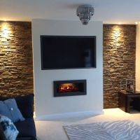 A false chimney breast, Split slate in the alcoves with ...