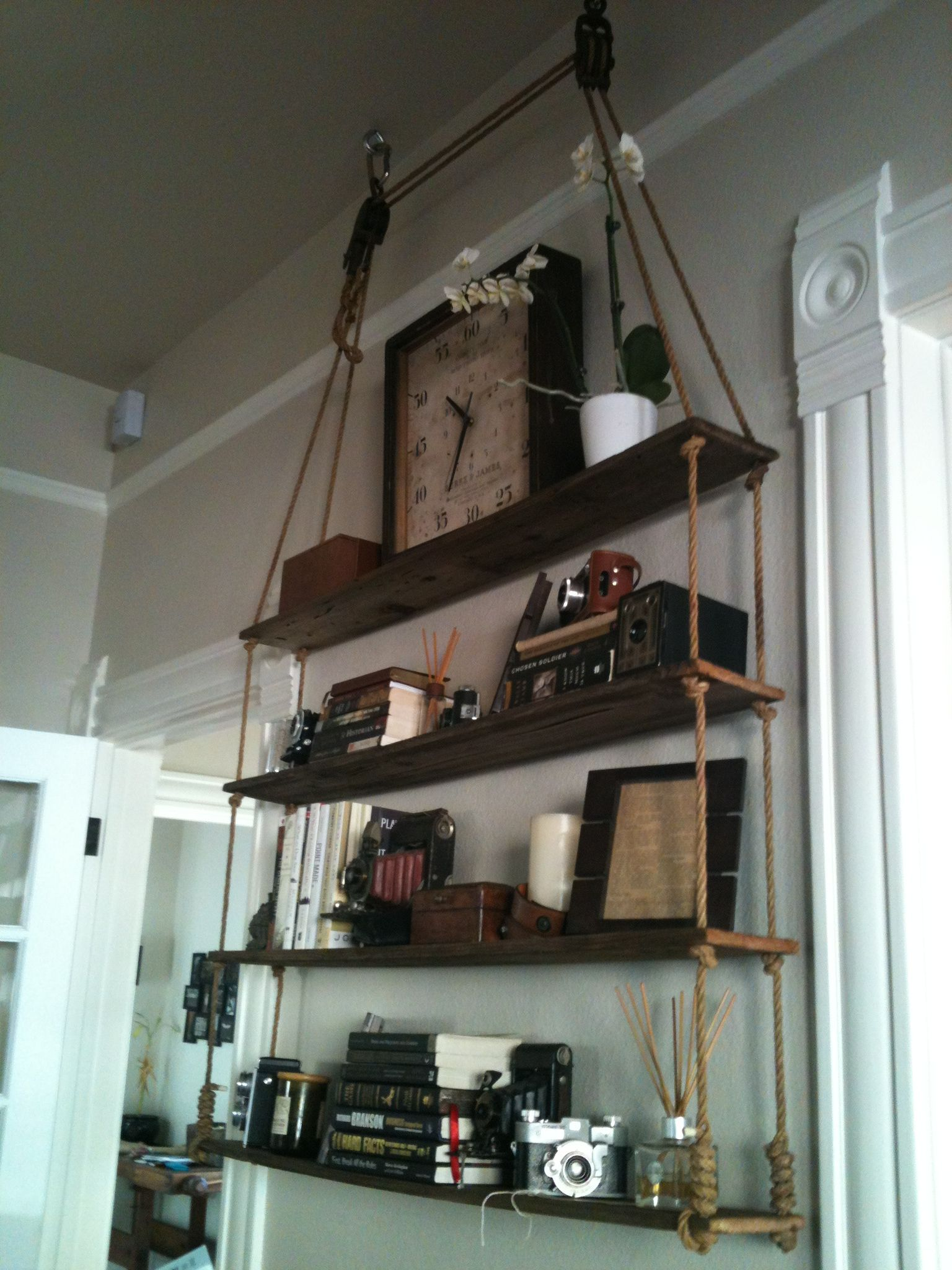 Hanging Rope Shelves With Pulleys And Old Fence Boards As