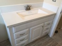 Custom built white concrete countertop with integrated ...