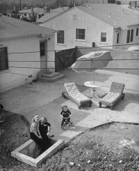 Backyard entrance to fallout shelter. Cold War scare had ...