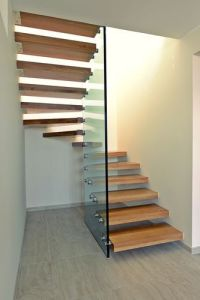 Half-turn staircase / glass railing / wooden steps ...