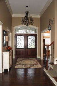 Entry with beautiful doors and chandelier. #entryways #