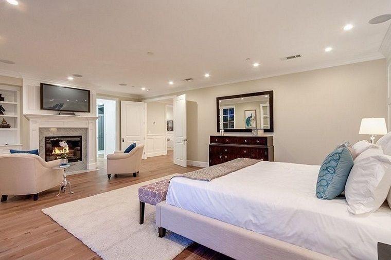 dormitorio matrimonial moderno con chimenea  Lamparas