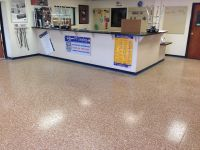 "Commercial floor, retail. 1/4"" Saddle Tan flake blend"