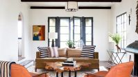 The living room features modern and timeless furnishings ...
