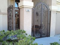 Wrought iron entry gate and porch enclosure
