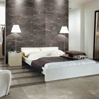 This modern bedroom features SILK SILVER marble effect ...