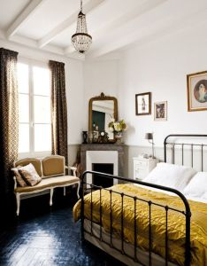 Lacquered herringbone floor corner fireplace great art and mirror placement antique bed beautiful mustard color also pin by mikayla baldwin on       pinterest peaceful rh