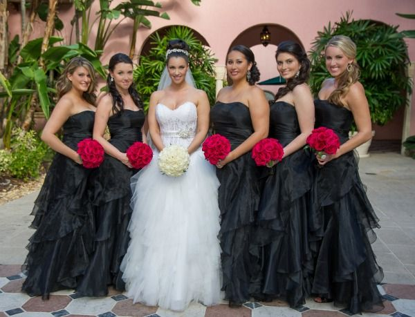 Bridesmaids In Black Dresses & Bold Red Flowers At This