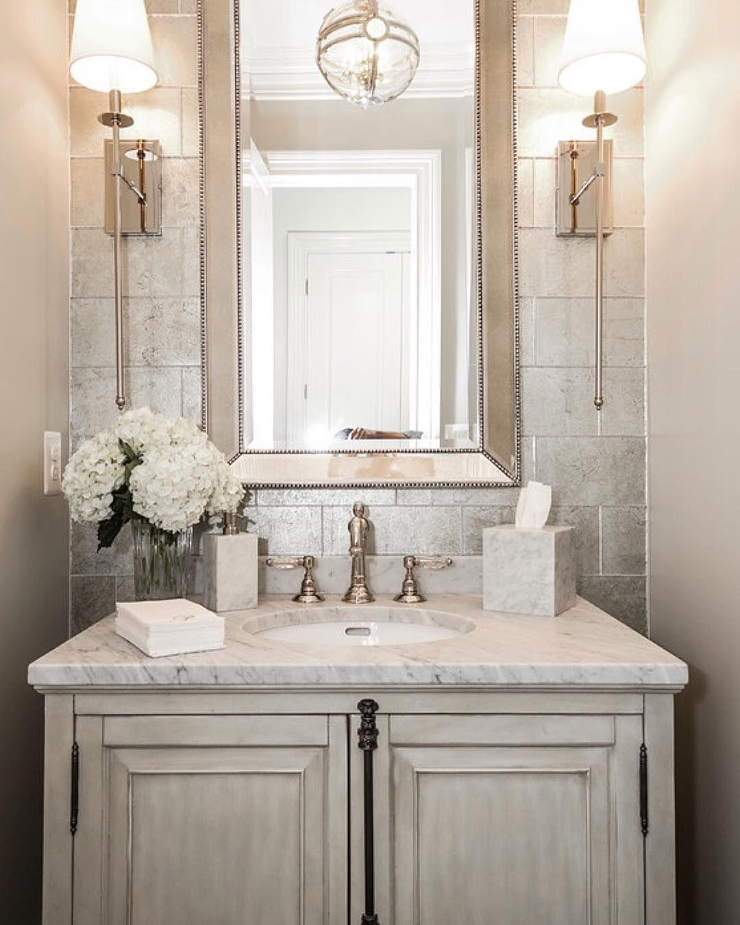 Such an elegant powder room By Castlwood Custom Builders