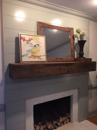 This fireplace transformation started with covering the ...