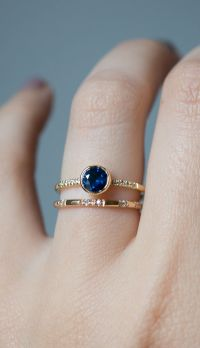 a Classic deep blue sapphire engagement ring stands out ...