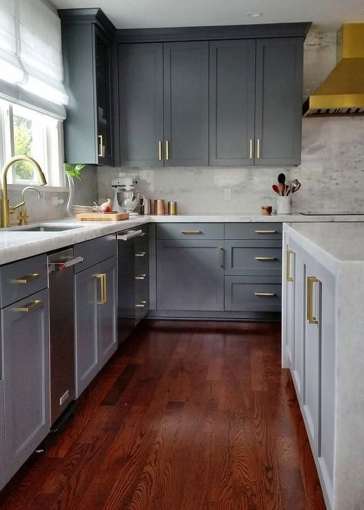 Stunning gray kitchen with gold accents boasts cherry