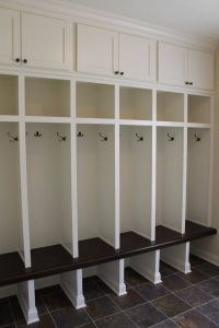 Custom built mudroom lockers with upper cabinets, solid