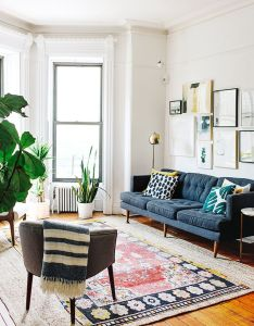 family of four shares their square foot brooklyn apartment navy living roomsliving room also rh pinterest
