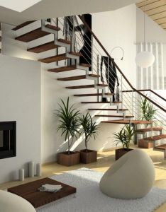 This modern living room has gorgeous floating stairs raising elegantly to the second floor we love incredible hardwood flooring and fun chairs in also decoracion de interiores buscar con google rh pinterest