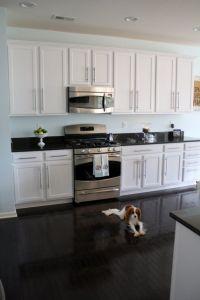 White cabinets, dark floor, wall color sherwin williams ...