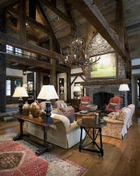 Love the lofted ceilings and dramatic fireplace. Lodge ...