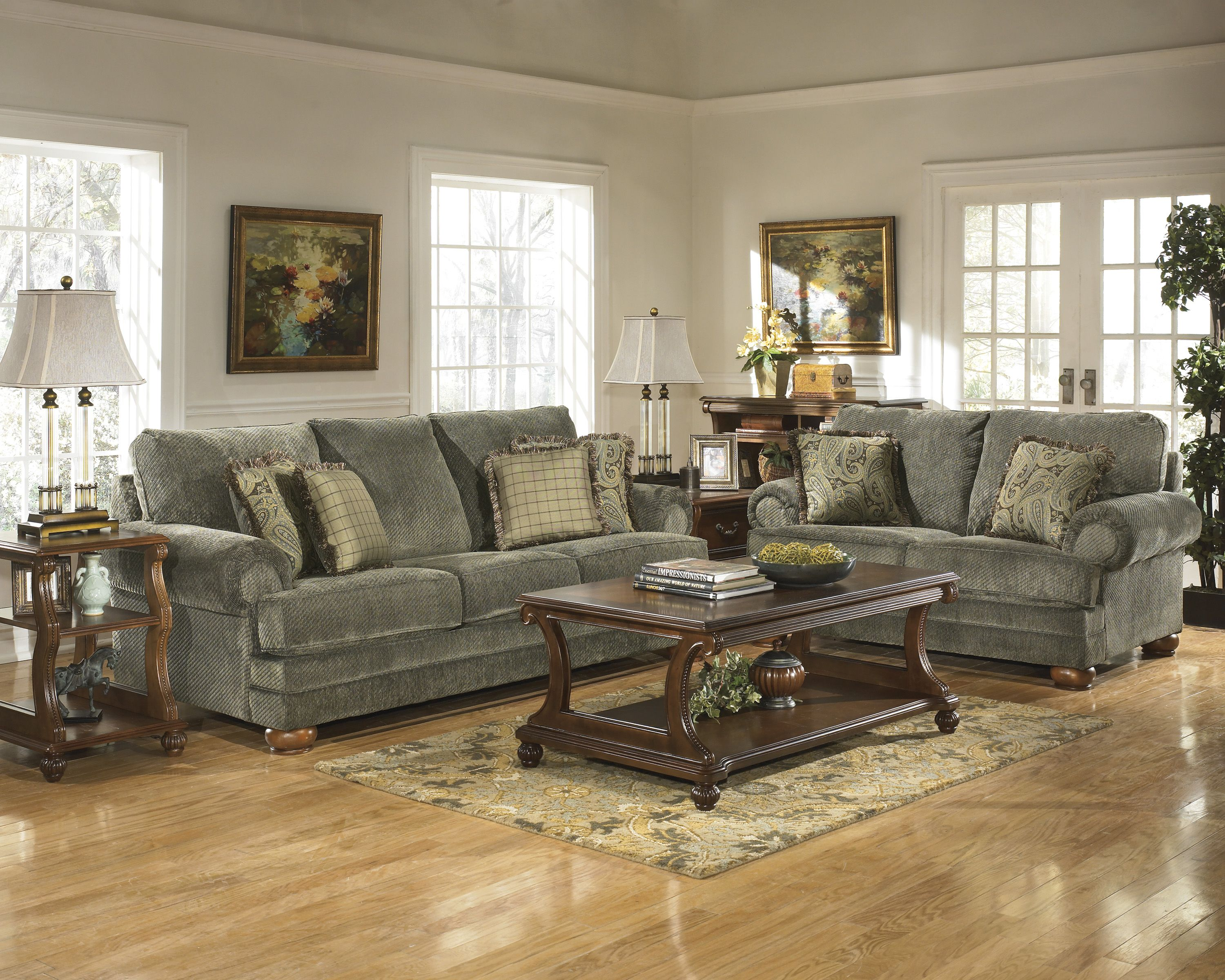 ashley furniture montgomery sofa cindy crawford sectional mocha living room set