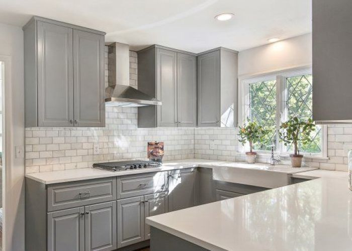 Gray shaker cabinets white quartz counter tops grecian marble subway tile and  also