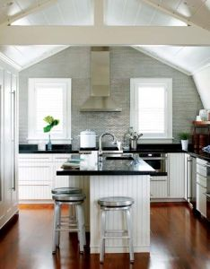 The kitchen   walls and ceiling follow gambrel roofline also home rh pinterest