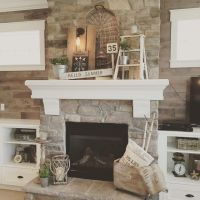 Living Room decor - rustic farmhouse style featuring stone ...