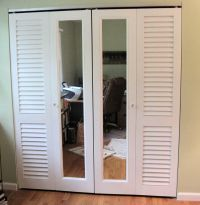 A combination of Plantation louvered doors and mirror