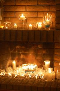 Fireplace filled with candles, Looking for something to do ...