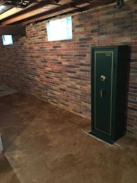 This basement wall is a poured concrete with a brick ...