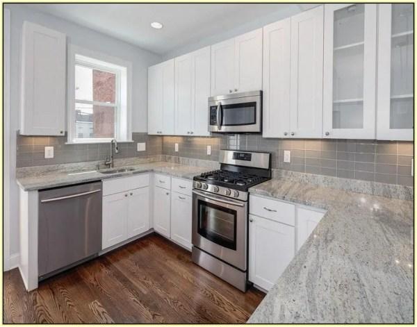 white kitchen with grey granite White Kitchen Cabinets With Gray Granite Countertops