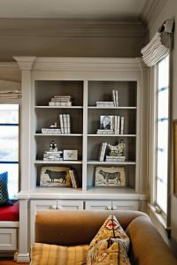 Molding on the bookshelves with contrasting color painted ...