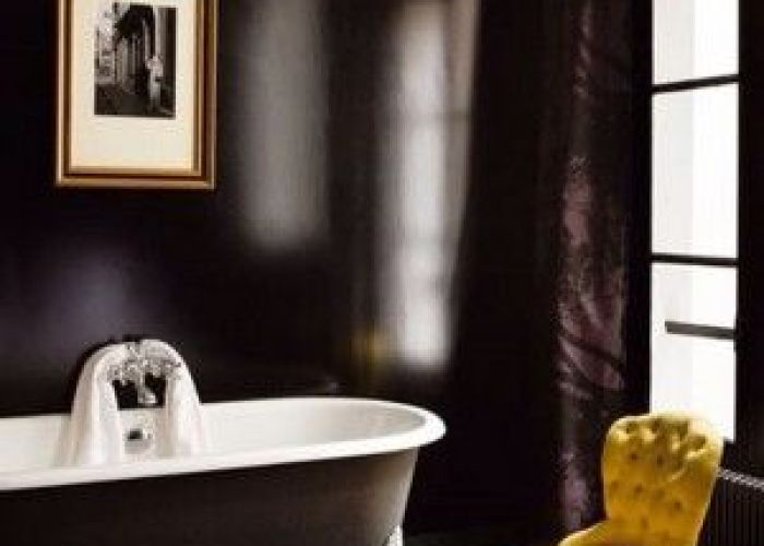 Dark nuance of bathroom interior design idea with white bathtub and tiny yellow chair in black painted wall green ceramic floor also  love the contrast although for my taste would