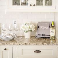 Venetian Gold Light Granite with off white subway tile and ...