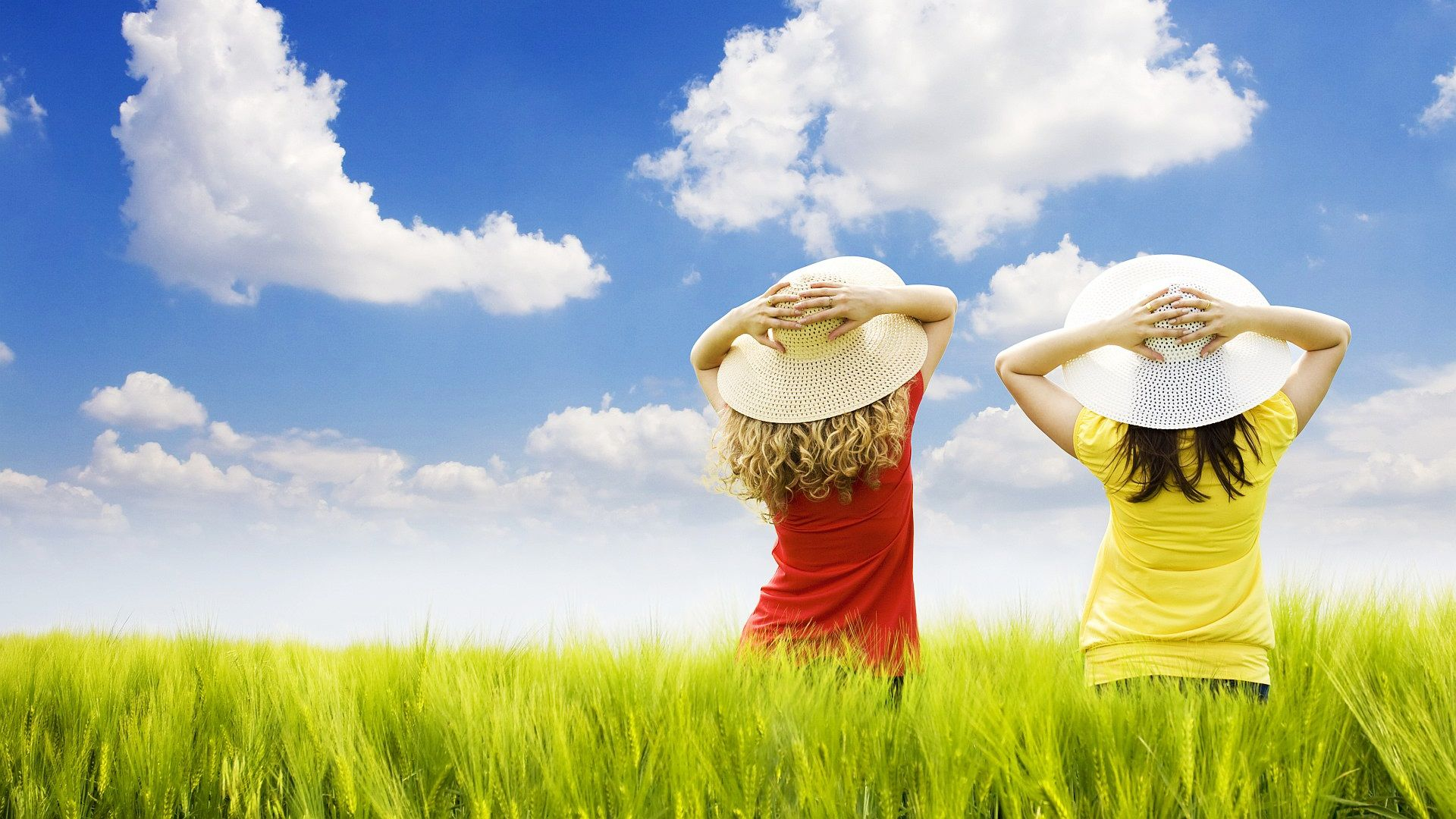 free wallpapers - two girls standing in the field wallpaper